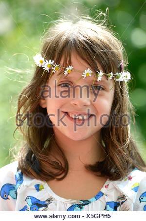 Smiling girl wearing a floral garland, portrait, Stuttgart, Baden-Württemberg, Germany - Stock Photo