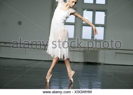A female ballet dancer doing toe-dance - Stock Photo