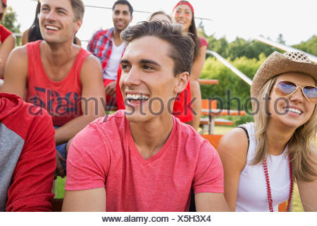 Man laughing at sporting event - Stock Photo