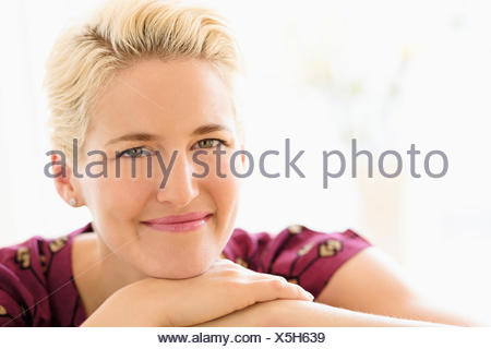 Portrait of young woman indoors - Stock Photo
