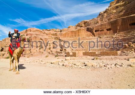 Man riding a camel, Petra, Jordan, Middle East - Stock Photo