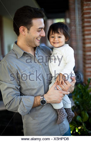 Italy, Lombardy, Milan, Father and daughter (18-23 months) - Stock Photo