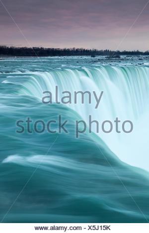 Dawn at the brink of the Canadian Horseshoe Falls, Niagara Falls, Ontario, Canada - Stock Photo