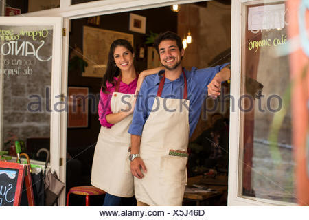 Restaurant owners standing at entrance of cafe, Palma de Mallorca, Spain - Stock Photo