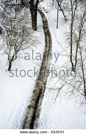Walking path in the winter, seen from above. - Stock Photo
