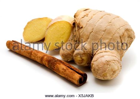 Ginger Zingiber officinale and Indonesian Cinnamon quills Cinnamomum burmannii on a white background - Stock Photo