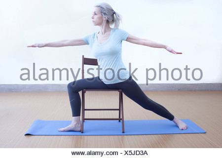 Mature woman in warrior pose - Stock Photo