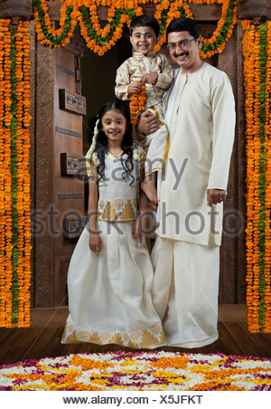 Portrait of a South Indian family - Stock Photo