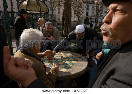A group of men meet every afternoon to play checkers in the Square Leon Serpollet. - Stock Photo