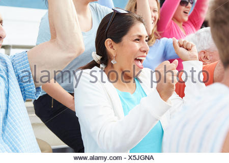 Woman In Crowd Celebrating At Sports Event - Stock Photo