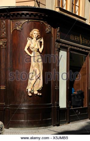 Art Nouveau house emblem of a lascivious woman, wood relief on the facade of the Caffè per Lei Cafe, historic district, Prague - Stock Photo