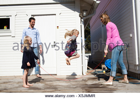 Girl jumping the rope - Stock Photo