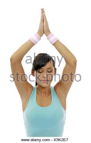 Frau Jung Yogauebung Innen Yoga Meditieren Meditation Gesundheit Wellness Entspannung Erholung Entspannen Erholen Ausgeglichen A - Stock Photo