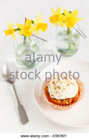 Glutenfree Carrot Coconut Banana Cupcakes, Laid table - Stock Photo