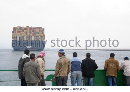 Egypt, port Said, container ship in the Suez Canal, view of a ferry, - Stock Photo