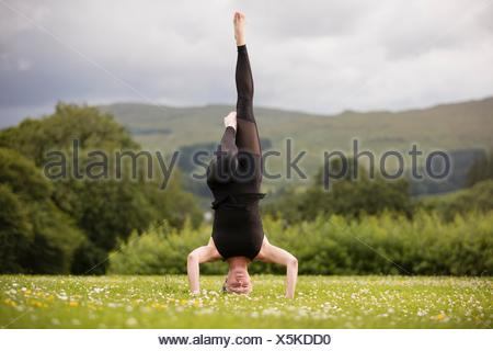 man upside down with his head in a bucket stock photo  alamy