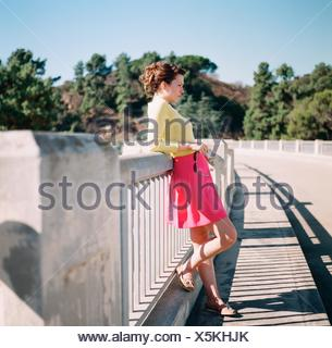 Side Of A Serious Young Woman Standing Outdoors - Stock Photo