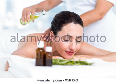 Smiling woman getting an aromatherapy treatment - Stock Photo