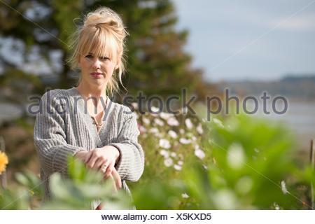 Portrait of woman in organic garden, Orust, Sweden - Stock Photo