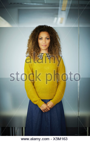 Portrait of female office worker - Stock Photo
