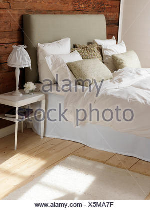 Sweden, Bedroom with wood and white color theme - Stock Photo
