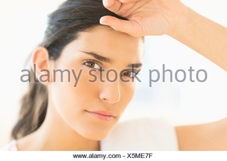 Portrait of tired woman - Stock Photo