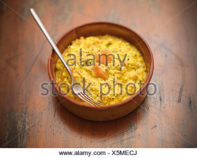 Bowl of scrambled eggs and salmon - Stock Photo