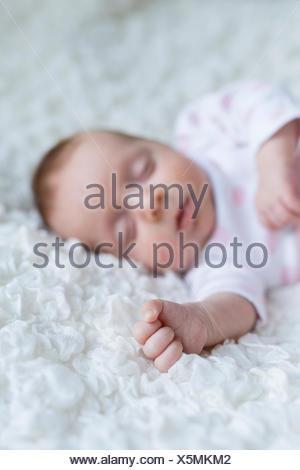 Hand of sleeping newborn baby girl - Stock Photo