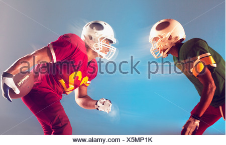 Blurred view of football players facing each other - Stock Photo