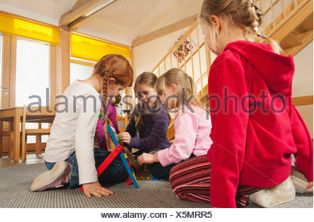 Germany, Children in nursery playing together - Stock Photo
