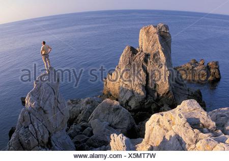 Coast, near Le Croisic, Brittany, France, Europe, rocks, sea, person - Stock Photo
