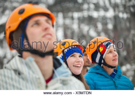 Future participants watch the ice climbing clinics at the Kids' Wall during the Ouray Ice Festival at the Ice Park in Ouray, Colorado. - Stock Photo