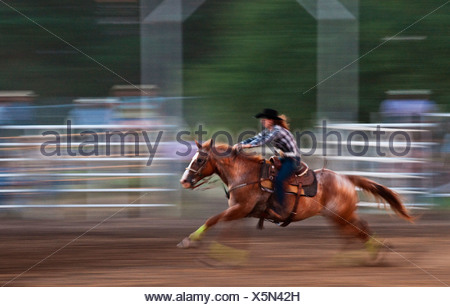 Cowgirl And Cowboy Galloping On Their Horses Through A
