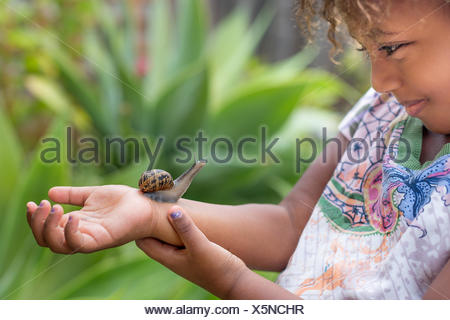 Girl with snail on arm - Stock Photo