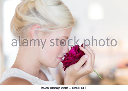Woman smelling rose - Stock Photo