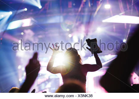 Finland, Uusimaa, Helsinki, Cheering young woman at Summer Sound Festival - Stock Photo