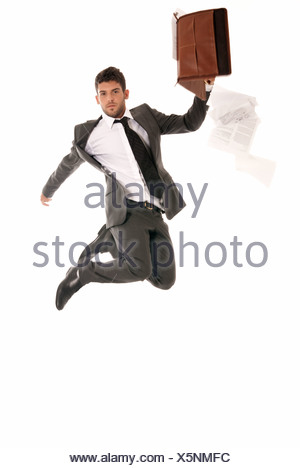 Young businessman jumping with open briefcase falling papers copy-space isolated on white background. - Stock Photo