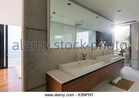 Sinks and mirrors in modern bathroom - Stock Photo