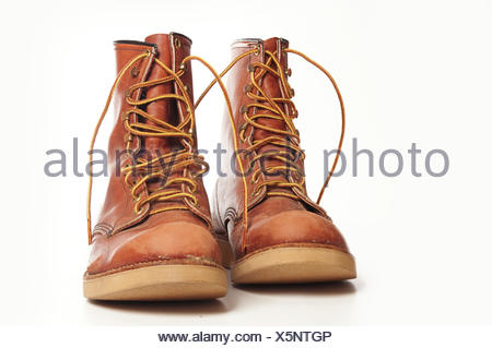 Men's rugged leather boots isolated against white background - Stock Photo