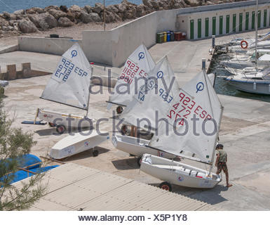 Young boy preparing his jolly boat - Stock Photo
