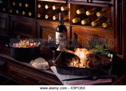 leg of lamb with vegetables and ham - Stock Photo
