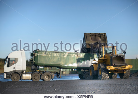 Coal loaded onto truck at surface mine - Stock Photo