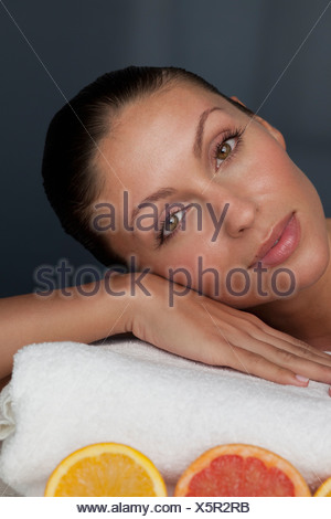 Woman resting her head on towel - Stock Photo