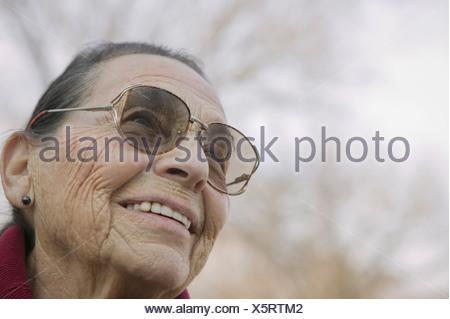 Portrait of senior woman wearing eyeglasses - Stock Photo