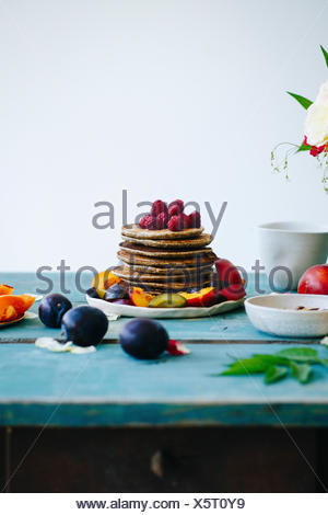 Pancakes on the green wooden table - Stock Photo