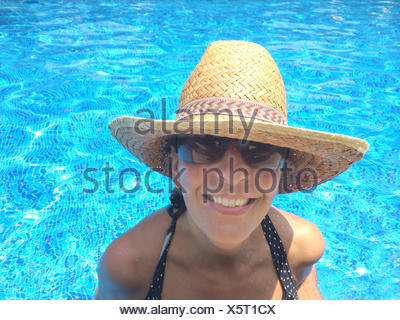 Smiling woman in swimming pool - Stock Photo