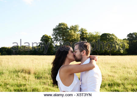 Hampstead Heath, London, UK, couple kissing outdoors, couple sunset at park - Stock Photo