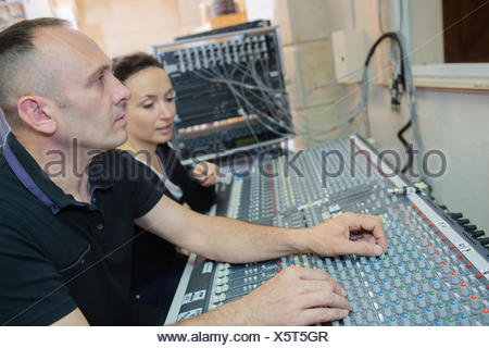 sound engineer co-working in a mission - Stock Photo