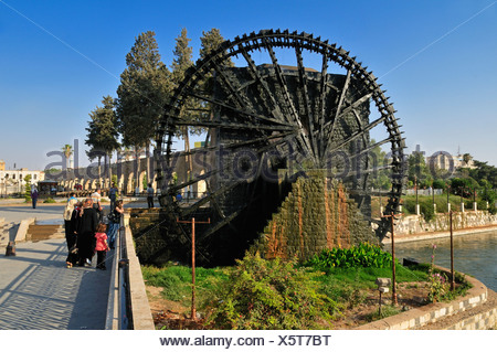 Noria waterwheel on the Orontes River in Hama, Syria, Middle East, West Asia - Stock Photo
