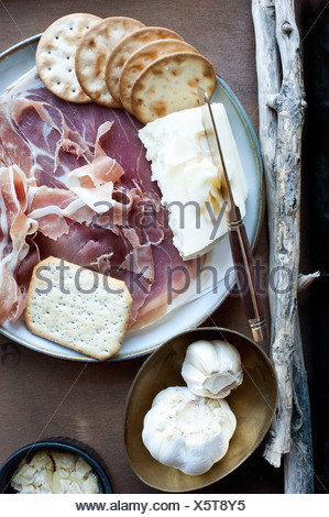 Garlic, crackers, cheese and meat - Stock Photo